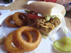 Fried oyster po' boy with onion rings