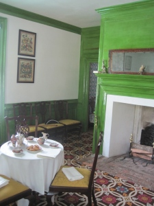 Ready for teatime. LOVE the crazy neon green varnished walls.